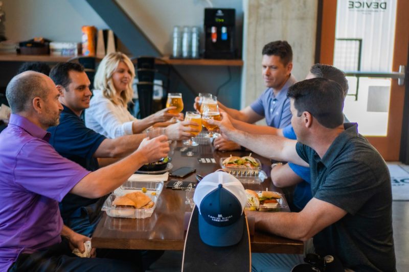Capital Rivers team enjoying a beer at local brewery in Sacramento.